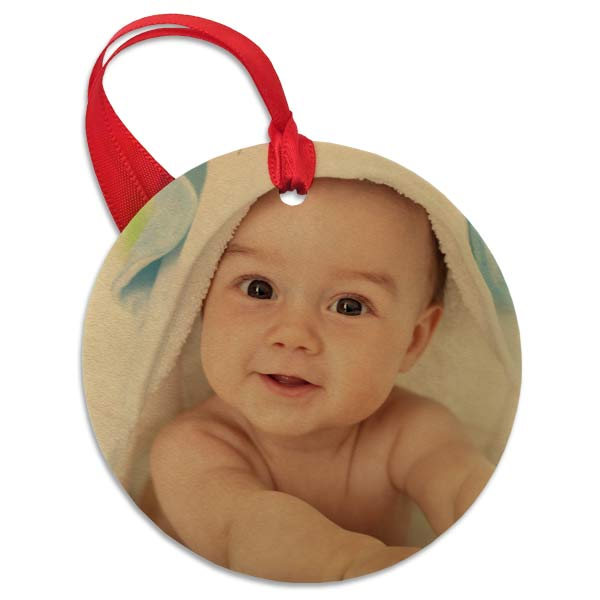 Add a rustic touch to any holiday display with our custom photo round wood ornament.