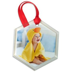 Add a personal touch to your tree with our hexagon glass photo ornament.
