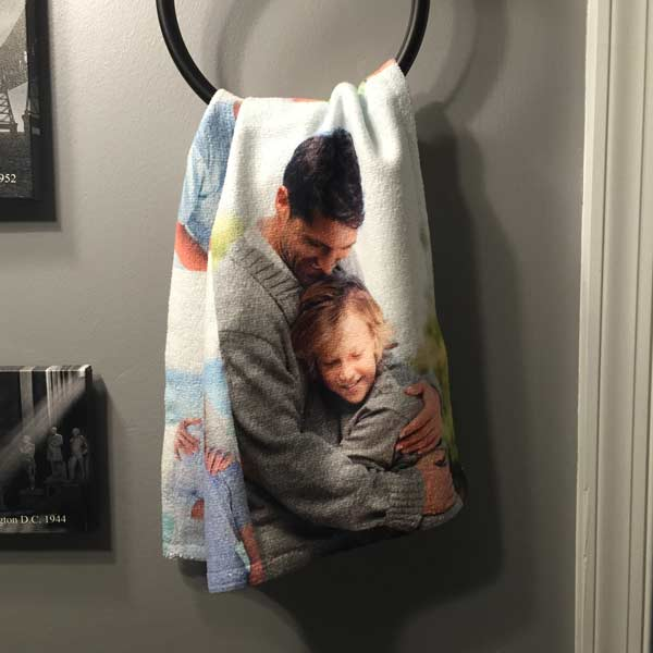 Personalized hand towel on display with custom photo added