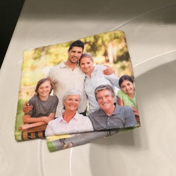 Close up of Photo Personalized Collage Washcloth next to a sink
