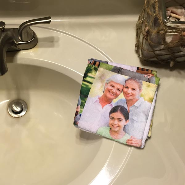 Photo Collage Washcloth displaying photos next to a Bathroom Sink