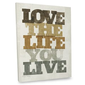Add an inspiring twist to your decor with our love the life your live quote canvas.