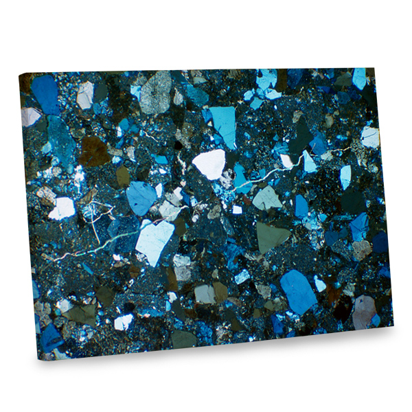 Add an abstract feel to your decor with our blue tone broken glass canvas print.