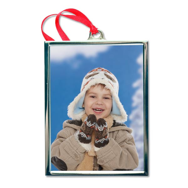 In corporate your favorite memories into your holiday décor, with our silver frame ornament.