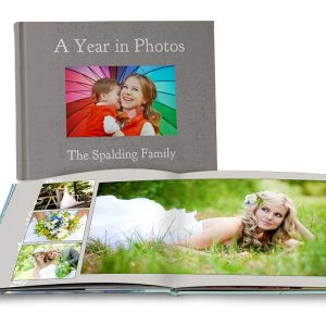 Create a custom wedding album for your photos or a year book with quality lay flat pages